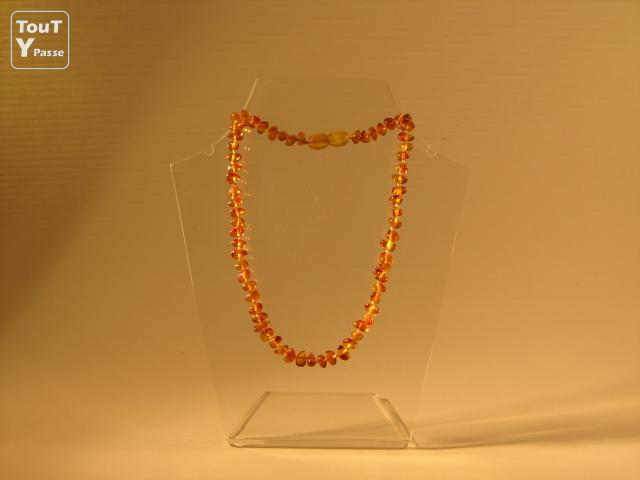photo de Collier d'ambre bébé BAROQUE PLAT couleur COGNAC